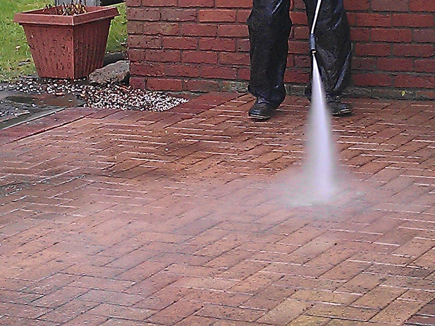 Photo of block paving being cleaned with a jet wash.