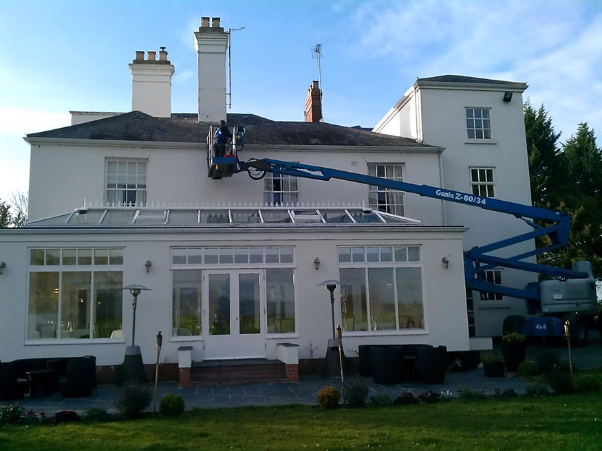 Photo of gutter cleaning being done from a cherry-picker